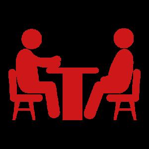 Piktogramm Beratung, zwei Personen sitzen an einem Tisch